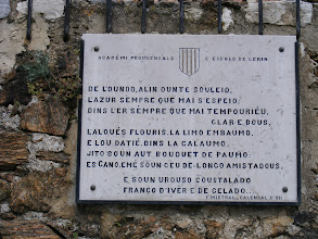 Photo: A typical example of a plaque in the local dialect.