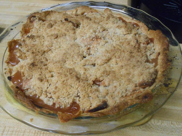 Place the pie on a cookie sheet to catch any drips, and bake in...