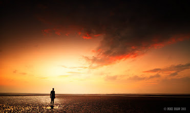 """Photo: I Stand  I stand and watch As the world moves The sun rises and sets And days pass by I stand and watch As the tide ebbs and flows And the seas call I stand and watch As time turns the sky From day to night And the stars fill my world I stand and watch.  Another from Crosby beach and Antony Gormleys installation """"Another Place"""" one of the most surreal places to spend time and just watch."""