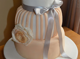 Peach and white wedding cake