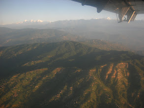 Photo: Looking out of the window in the Twin Otter flight to Lukla