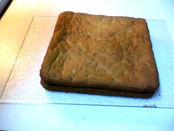 Remove from the pan and place it over the bottom cookie and fudge layer...