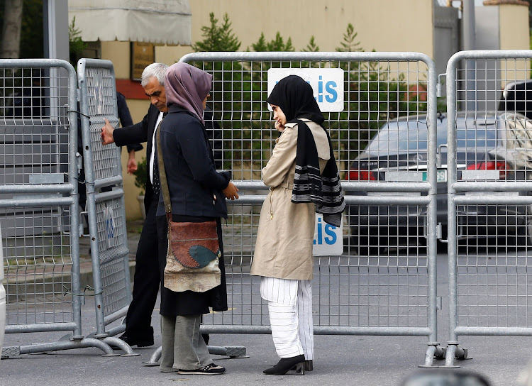The fiancee (left) of Saudi journalist Jamal Khashoggi and her friend wait outside Saudi Arabia's consulate in Istanbul, Turkey, October 3 2018. Picture: REUTERS/OSMAN ORSAL
