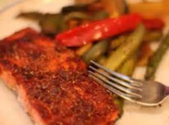 To serve, remove the entire salmon filet and place it on a bed of...