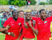 Burundi players celebrate after their 1-1 draw against Gabon that qualified the tiny east African nation to their first ever Africa Cup of Nations.