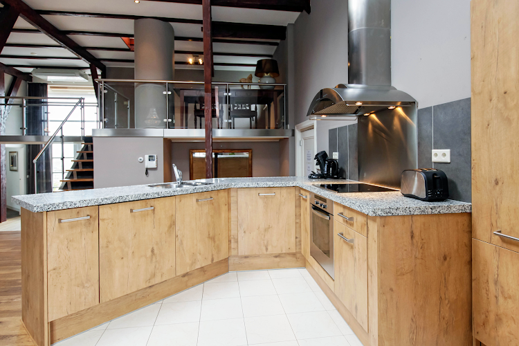 Fully equipped kitchen at Leidsesquare Suites