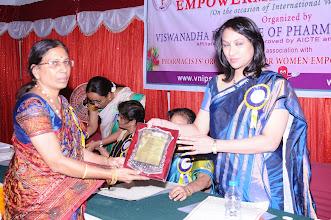 Photo: Dr. M. Savithri, Organizing Secretary honoring Dr. A.D. Madhavi - Guest of Honor