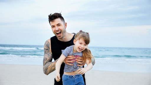Dwayne and his daughter, Liberty, at the beach in Australia.