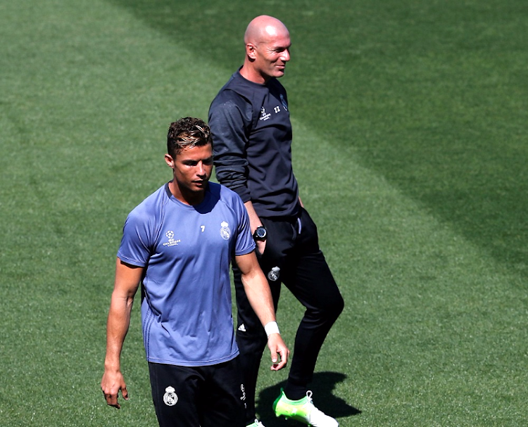 Real Madrid's Cristiano Ronaldo (left) and coach Zinedine Zidane attend a training session at the Valdebebas training grounds in Madrid, Spain, on Tuesday. Picture: REUTERS/Sergio Perez