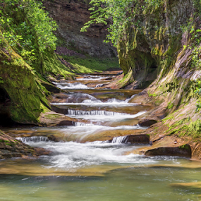 The Potholes at Fall Creek Gorge by Kenneth Keifer - Landscapes Waterscapes ( indiana, stream, pot holes, gorge, waterfall, williamsport, sandstone, stone, rock, remote, blur, flow, landscape, attica, preserve, carved, nature, secluded, passage, creek, fall creek, crevice, long exposure, motion, the pot holes, fall creek gorge, the potholes, warren county, flowing, ravine, cliff, midwest, beautiful, cascades, canyon, forest, scenic, potholes, woods, rural, blurred, splashing, cataract, whitewater )