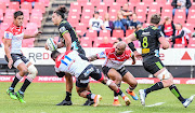 Jordie Barrett of the Hurricanes tackled by Aphiwe Dyantyi of the Lions during the Super Rugby match between Emirates Lions and Hurricanes at Emirates Airline Park on June 08, 2019 in Johannesburg, South Africa.