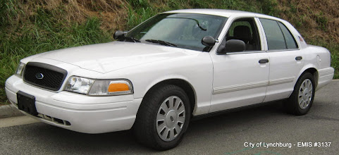 Photo: Lot 20 - (3137-1/3) - 2009 Ford Crown Victoria - 100,630 miles