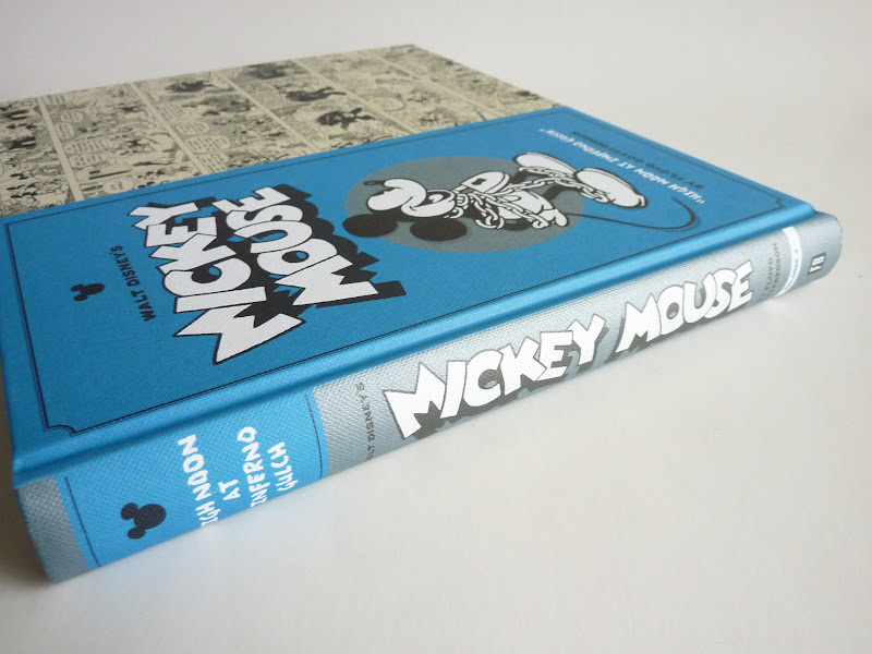 "Photo: Walt Disney's Mickey Mouse Vol. 3: High Noon at Inferno Gulch by Floyd Gottfredson  http://www.fantagraphics.com/mickey3  280-page black & white/color 10.5"" x 8.75"" hardcover • $29.99 ISBN: 978-1-60699-531-0 - Spine."