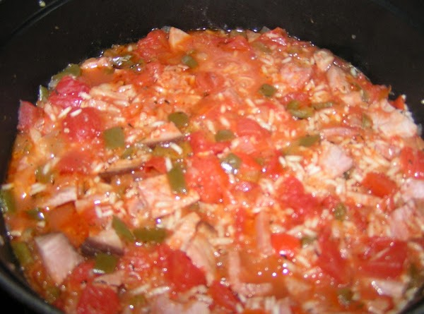 Add all seasoning, diced tomatoes, hot sauce and chicken broth; stir to combine. ...