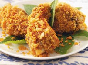 In a large shallow bowl, combine flour and taco seasoning. Add wings, a few...