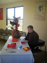 Photo: Humane Society of West Michigan's Home for the Holidays & Argus Program event with Author Jim Gorant (The Lost Dogs) signing books with the quietest dog in the place ;)