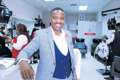 CUTTING EDGE DECISION: Auditor-turned-salon owner Moses Mbedhli officially opened his Mo Style Studio in Beacon Bay yesterday Picture: SISIPHO ZAMXAKA