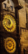 Photo: Astronomical clock, old town square at night.