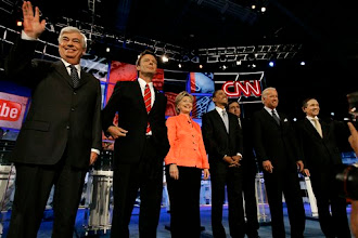 Photo: Democratic presidential hopefuls from left , Sen. Christopher Dodd, D-Conn.; former Sen. John Edwards, D-N.C.; Sen. Hillary Rodham Clinton, D-N.Y.; Sen. Barack Obama, D-Ill.; New Mexico Gov. Bill Richardson; Sen. Joseph Biden, D-Del.; and Rep. Dennis Kucinich, D-Ohio, stand together before the start of a debate sponsored by CNN, YouTube and Google at The Citadel military college in Charleston, S.C., Monday, July 23, 2007. (AP Photo/Mary Ann Chastain)