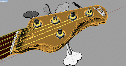 Photo: I've recreated the headstock from scratch. It looks similar but it's much simpler, there are no sharp edges etc. Compare it to the old headstock, and you'll see the slight differences, mostly around the neck-headstock joint. I'll also change the tuners a bit.