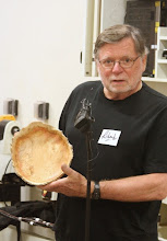 Photo: Richard Webster shows a natural-edge box elder burl bowl.