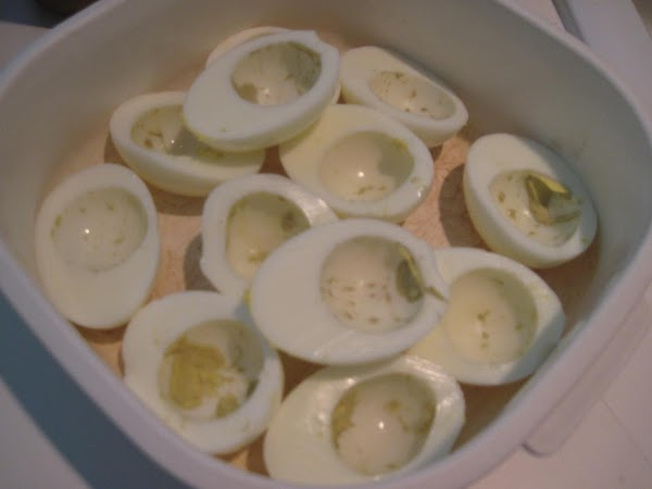 Hard boil the eggsPlace 1 dozen eggs in a pan so they all sit...