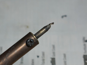 Photo: Here's my soldering iron tip. This is a cheapo no-name wand-style soldering iron. The tip's plating has completely gone and the tip is visibly corroding, to the point that there's a bite-sized chunk corroded *right through it*. This is what I'm using to solder all of my gear together, on a project as involved and as difficult as this one... I need a new tip, preferably a whole new soldering iron!