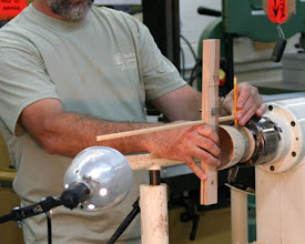 Photo: Mike uses a home made tool to find the depth of the bowl. He drilled a hole for the dowel and one for the tightening screw. He then cut a slit down the middle of the board to the hole for the dowel.