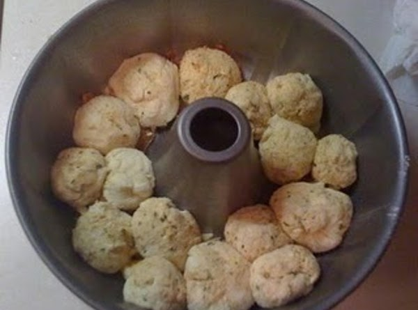 Roll each ball in Place butter mixture; layer in pan. Bake 30 to 35...