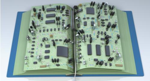 Picture of PCB components on a  book