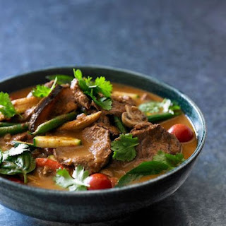 Red Beef And Vegetable Curry With Fresh Herbs.