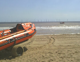 Photo: The lifeboat doing turns infront of the windfarm, the Zodiac training leaving it glistening in the sun, the radio transmissions clearly heard as they prepare to end the drill.