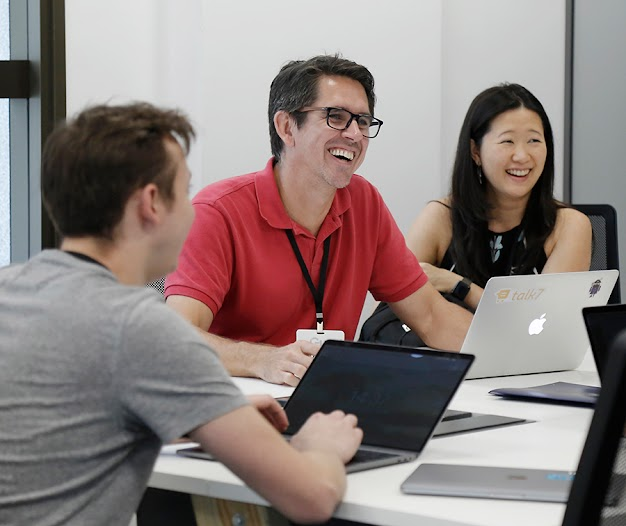 Group of startup founders working with a mentor