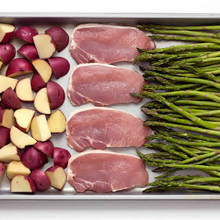 Sheet Pan Baked Parmesan Pork Chops Potatoes & Asparagus.
