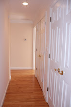 Photo: Hall to BR 1 and stairs, two large closets