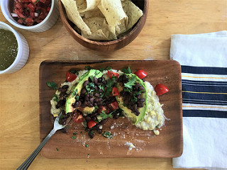 black bean-stuffed avocado over sweet corn puree teaser.jpg