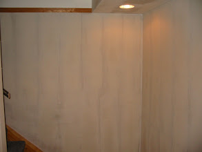 Photo: Cinder block wall with drywall mud smoothing it out. We'll spray some texture on it and paint as normal.
