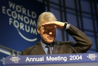 Photo: DAVOS/SWITZERLAND, 21JAN04 - William J. Clinton, Founder, William Jefferson Clinton Foundation; President of the United States (1993-2001) shielding his eyes from the limelight during his address at the 'Opening Lunch' at the Annual Meeting 2004 of the World Economic Forum in Davos, Switzerland, January 21, 2004. 