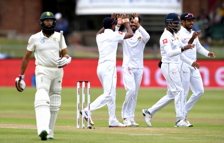 Dhananjaya de Silva and team mates of Sri Lanka celebrate the wicket of Hashim Amla of South Africa during day 2 of the 2nd Castle Lager Test match between South Africa and Sri Lanka at St George's Park on February 22, 2019 in Port Elizabeth, South Africa.
