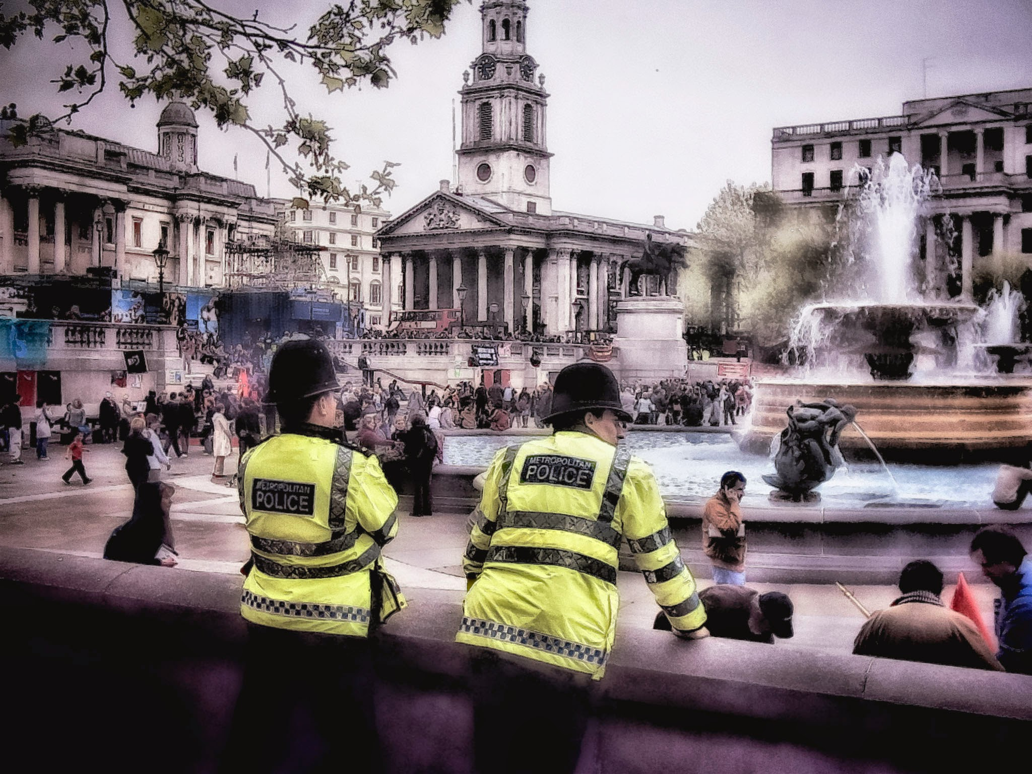 Photo: Police look on while May Day labor protests proceed. London - May 1, 2004.