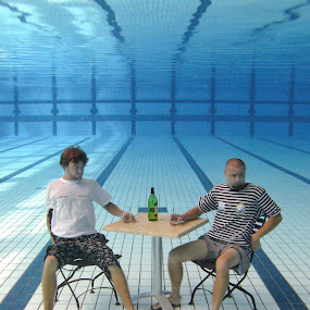 Fjaka by Antonio Rossetti - People Couples ( chair, pool, underwater, men, table, bottle )