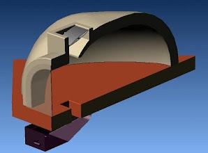 Photo: position pendant la chauffe porte fermée: l'air contourne la porte vitro-céramique par le tirroir cendrier ouvert , remonte dans le four par le trou de décendrage . à l'usage il semble qu'une bonne partie soit évacuer directement par la cheminée placée à l'aplomb sans alimenter le feu