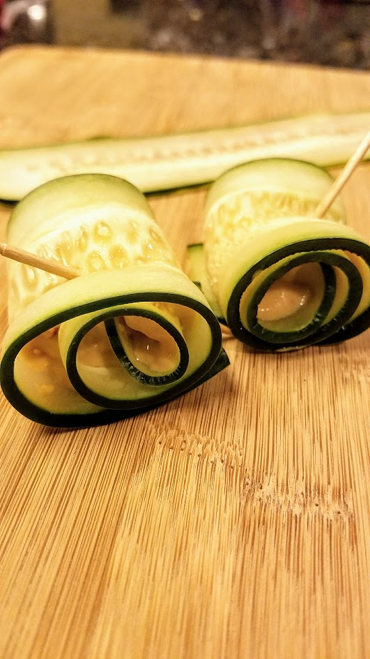 Slice cucumbers the long way to make cucumber roll ups for a healthy, vegetarian, gluten free bunch of bites for a party