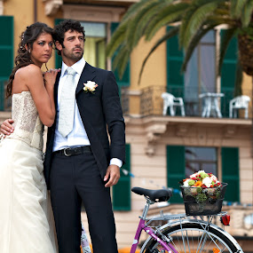 Italian Wedding by Kim Wilson - Wedding Bride & Groom ( italian, europe, exterior, husband, photography, bicycle, love, married, future, woman, resort, gown, bride, italy, black, man, male, white, image, traditional, female, horizontal, wife, wedding, outdoor, suit, hotel, day, groom, outside )