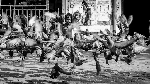 Flight of the spirit by dhritiman lahiri black white street candid iclickweddings