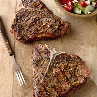 Greek-Seasoned T-Boned Steaks with Cucumber and Tomato Salad.