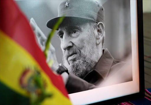 A photograph of Cuba's former President Fidel Castro is seen during a tribute ceremony, following the announcement of the death of Cuban revolutionary leader Fidel Castro in La Paz, Bolivia, November 26, 2016. REUTERS/David Mercado