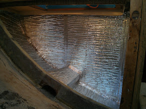 "Photo: 1/4"" thick Reflectix insulation installed on the outer perimeter of the ice box."