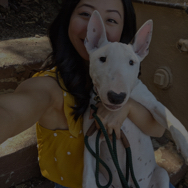 Woman posing for selfie with a bull terrier