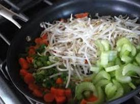 In a skillet over medium heat, heat sesame oil and lightly fry the onions,...